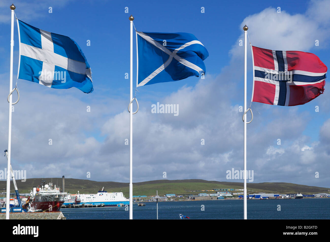 the shetland scottish and norwegian flags flying in lerwick stock