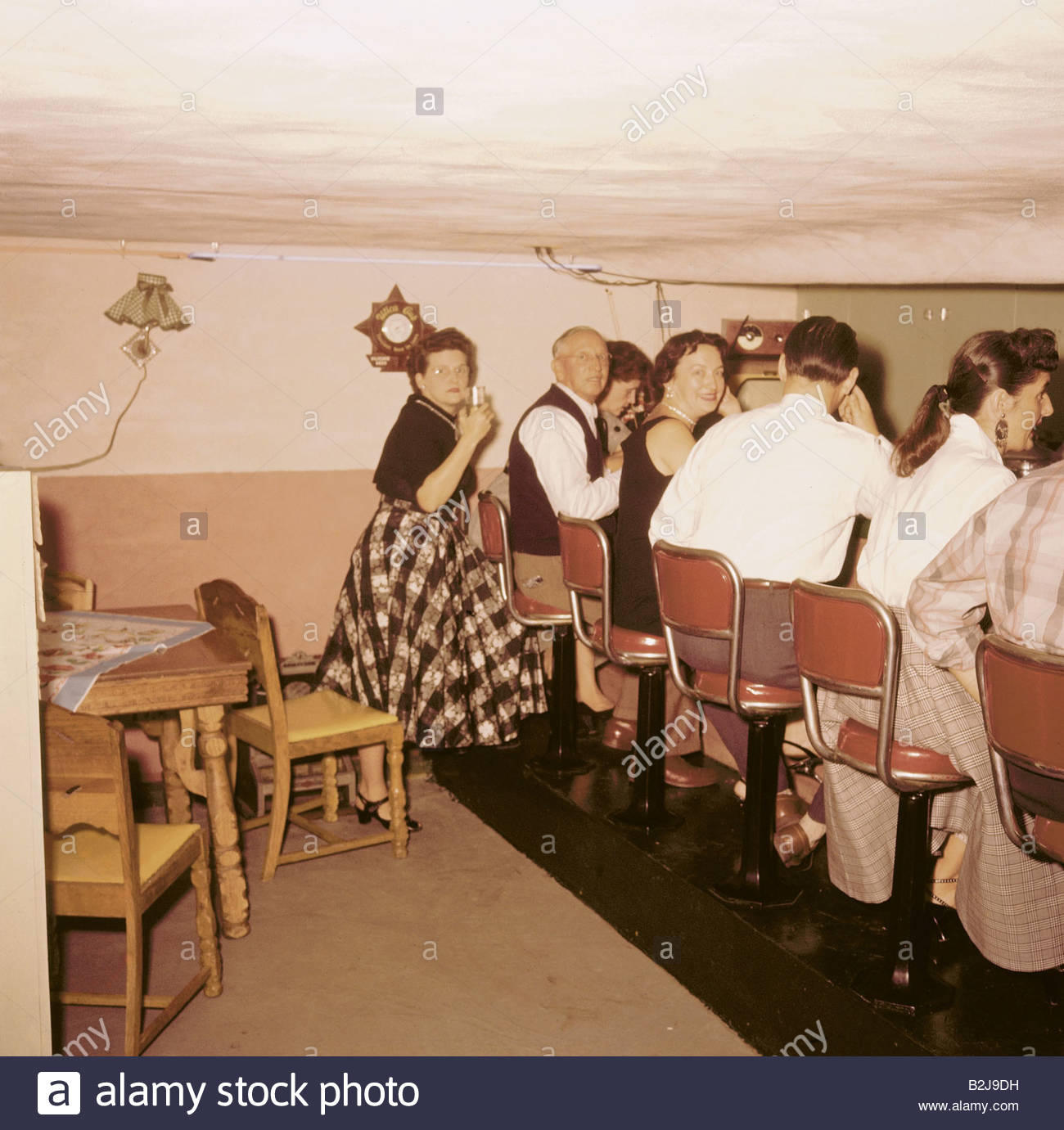 festivity parties house party in the basement usa 1950s bar stock