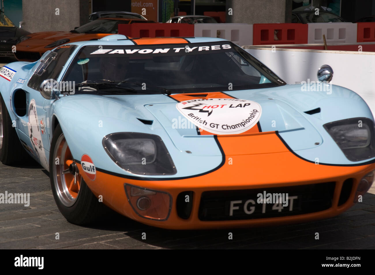 a blue and orange ford gt 40 racing car driving on a makeshift track stock photo royalty free. Black Bedroom Furniture Sets. Home Design Ideas
