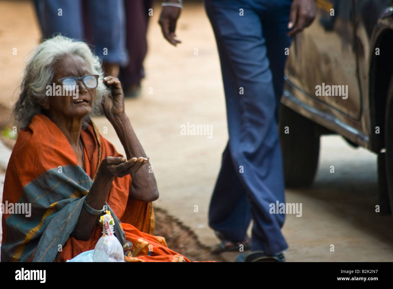 Old Homeless Woman Begging in the Streets of Mumbai India
