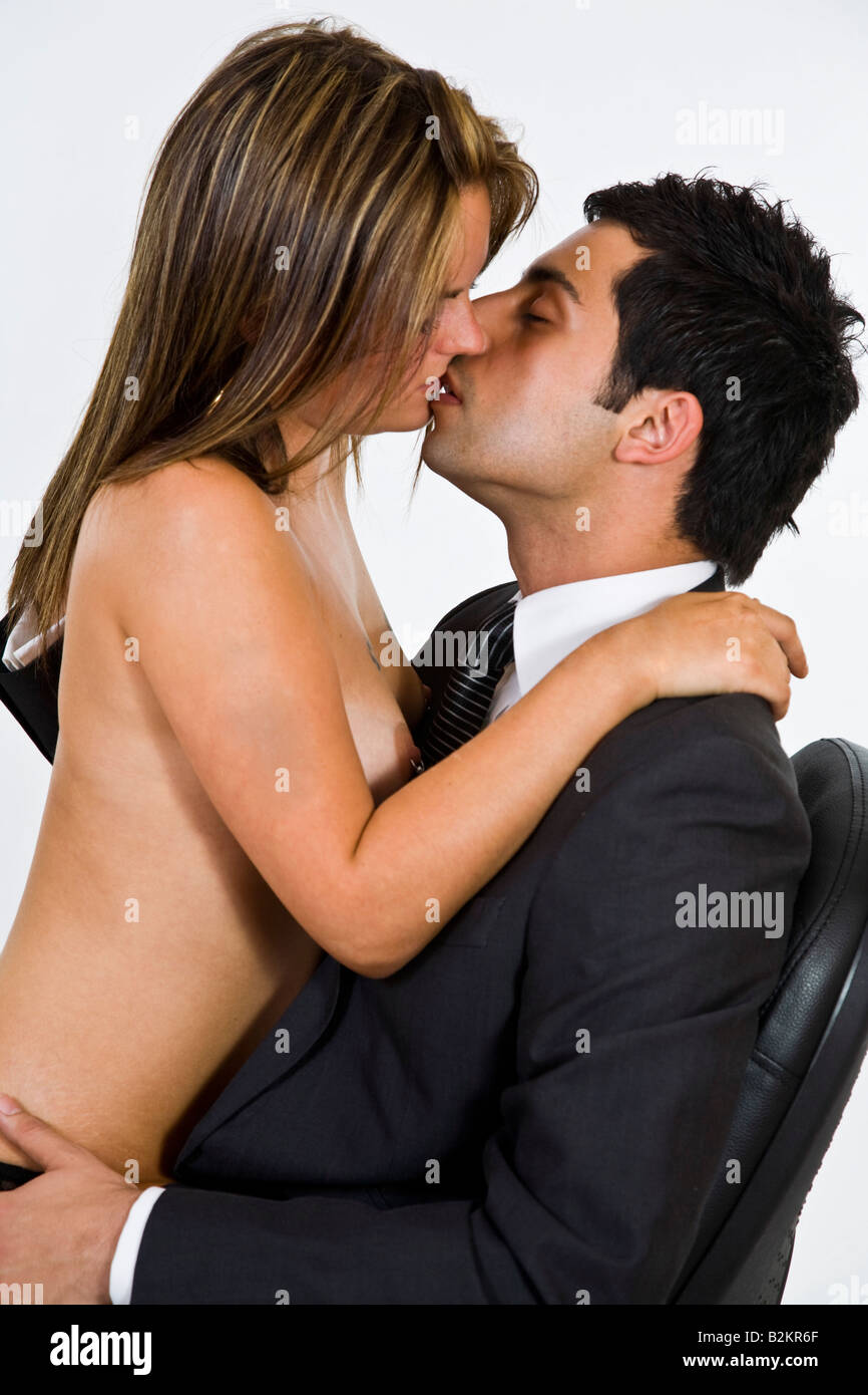 man kissing topless woman