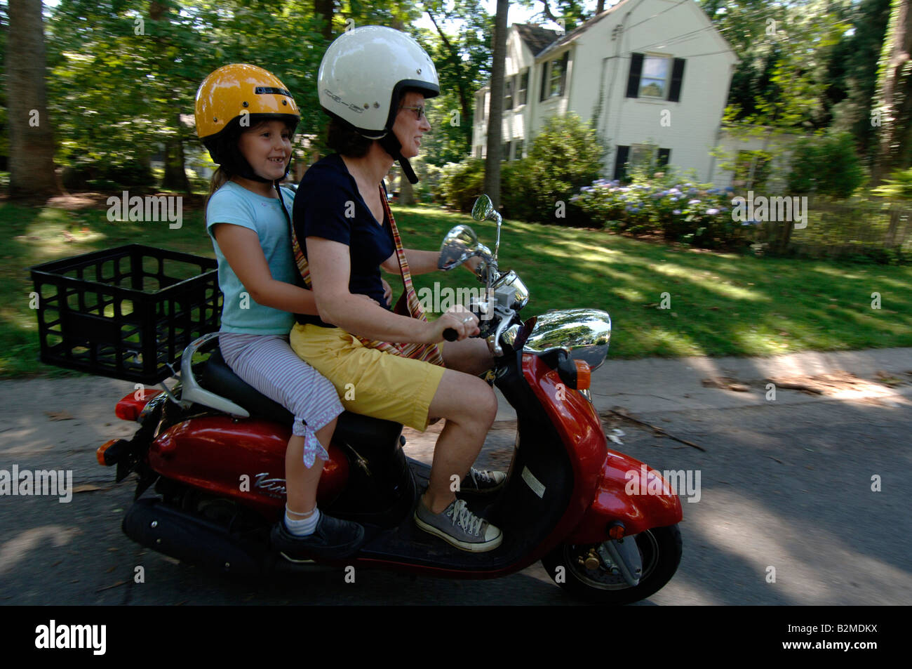 Woman and 7 year old ride Yamaha Vino scooter Stock Photo ...