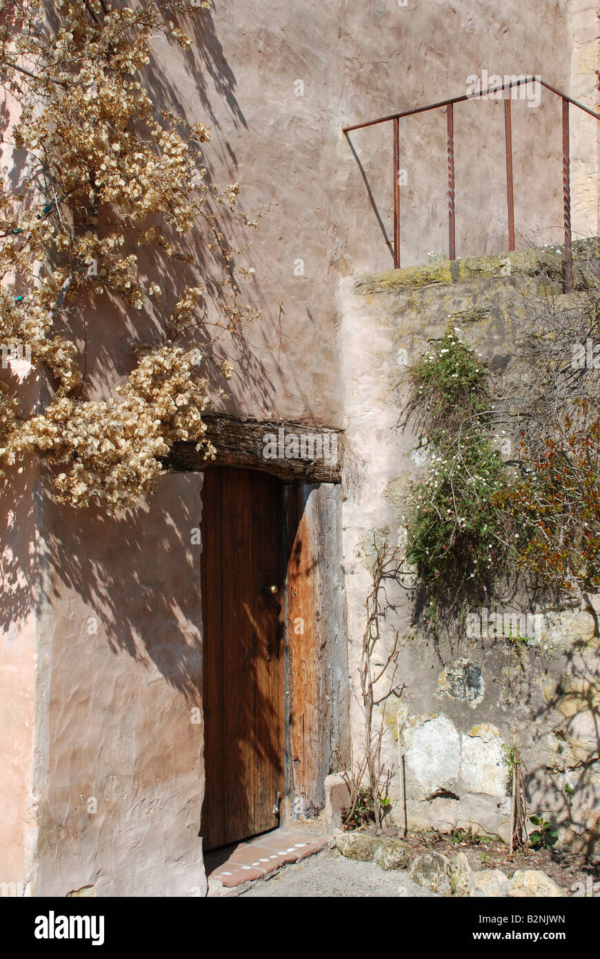 California mission style architecture - Spanish Mission Style Architecture Of Basilica With Wooden Doorway And Stone Steps Carmel Mission California