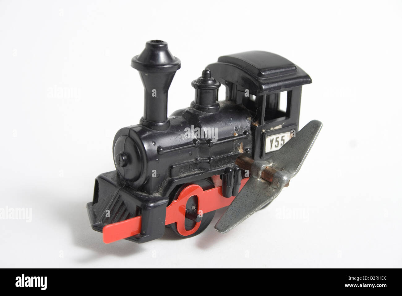 classic black and red metal old fashion antique toy windup train shot on white background with side and semi front view antique classic black