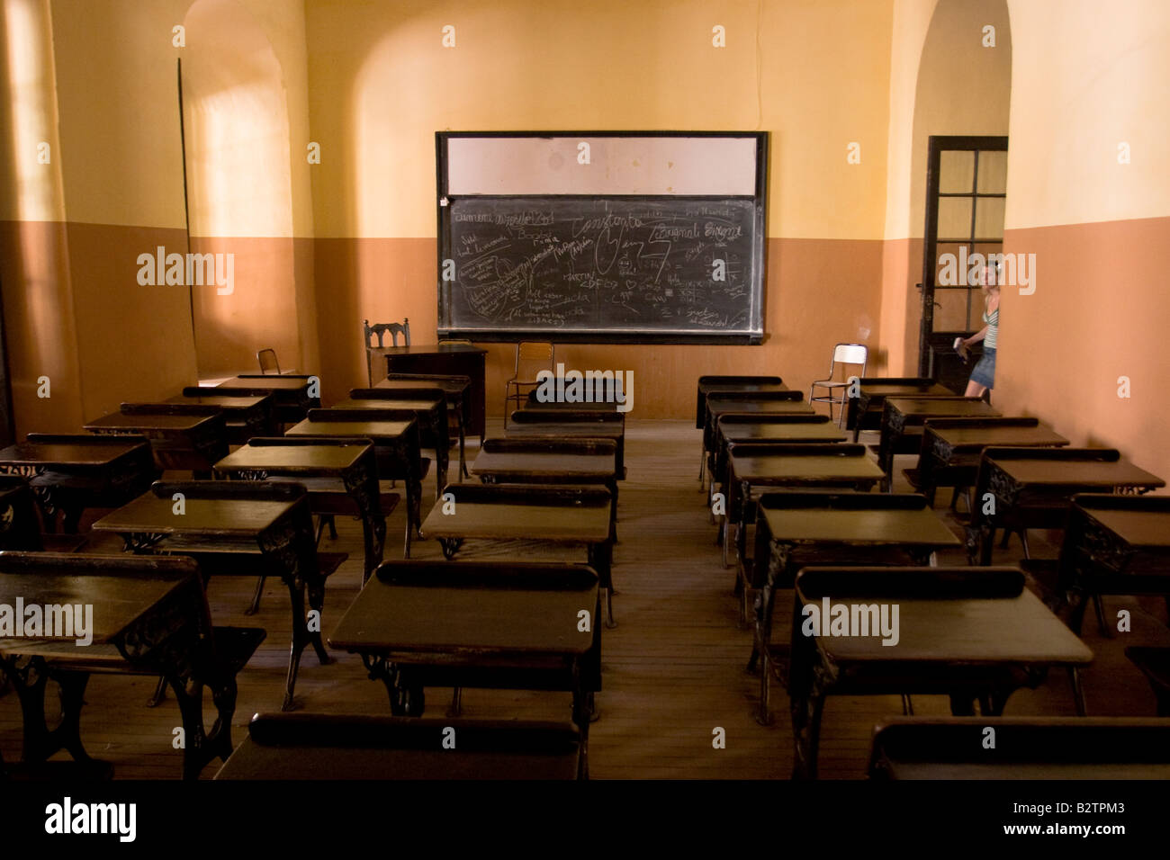 a classroom with antique benches inside colegio monserrat