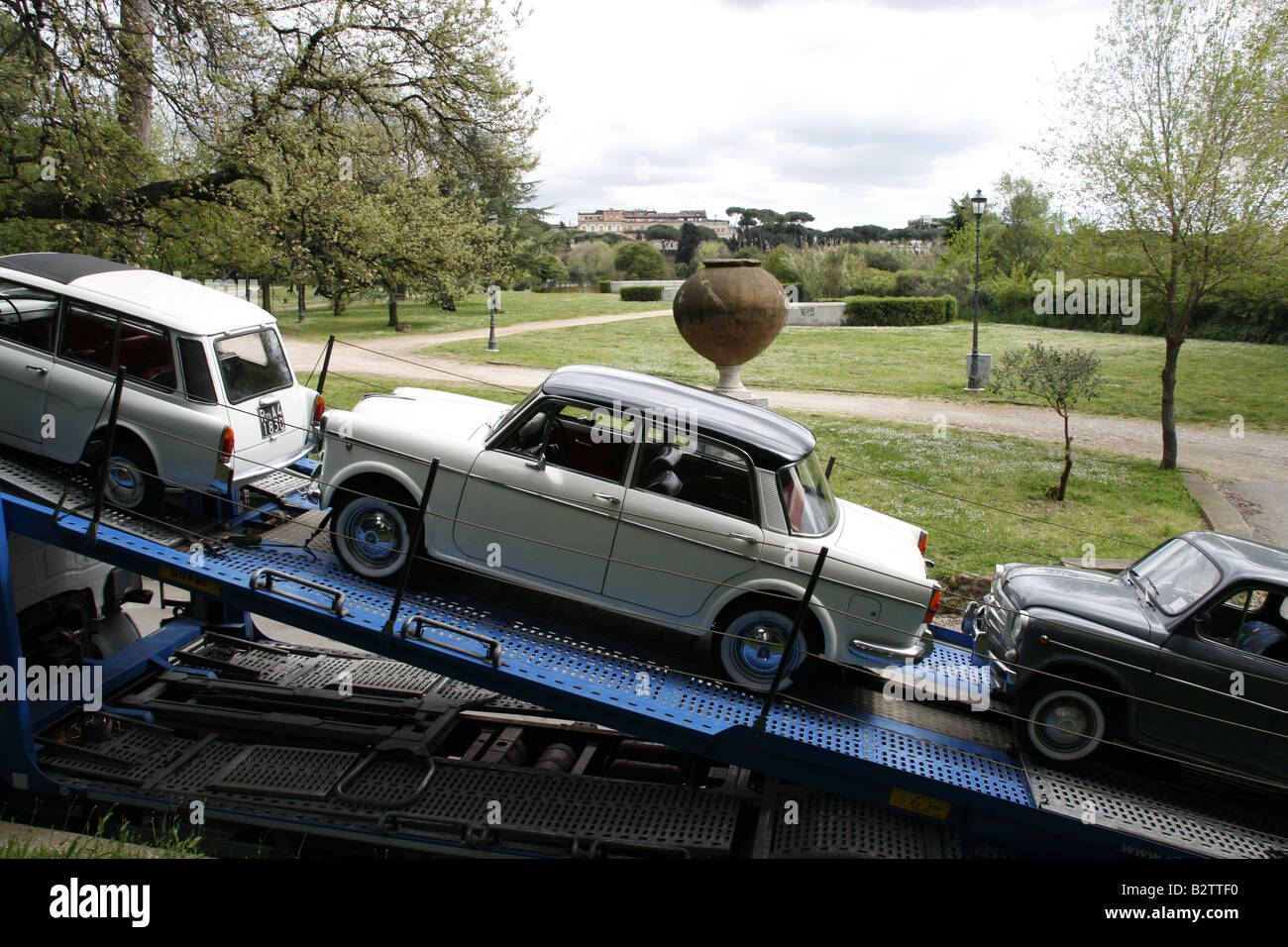 classic vintage cars on top of hgv truck lorry in rome italy Stock ...
