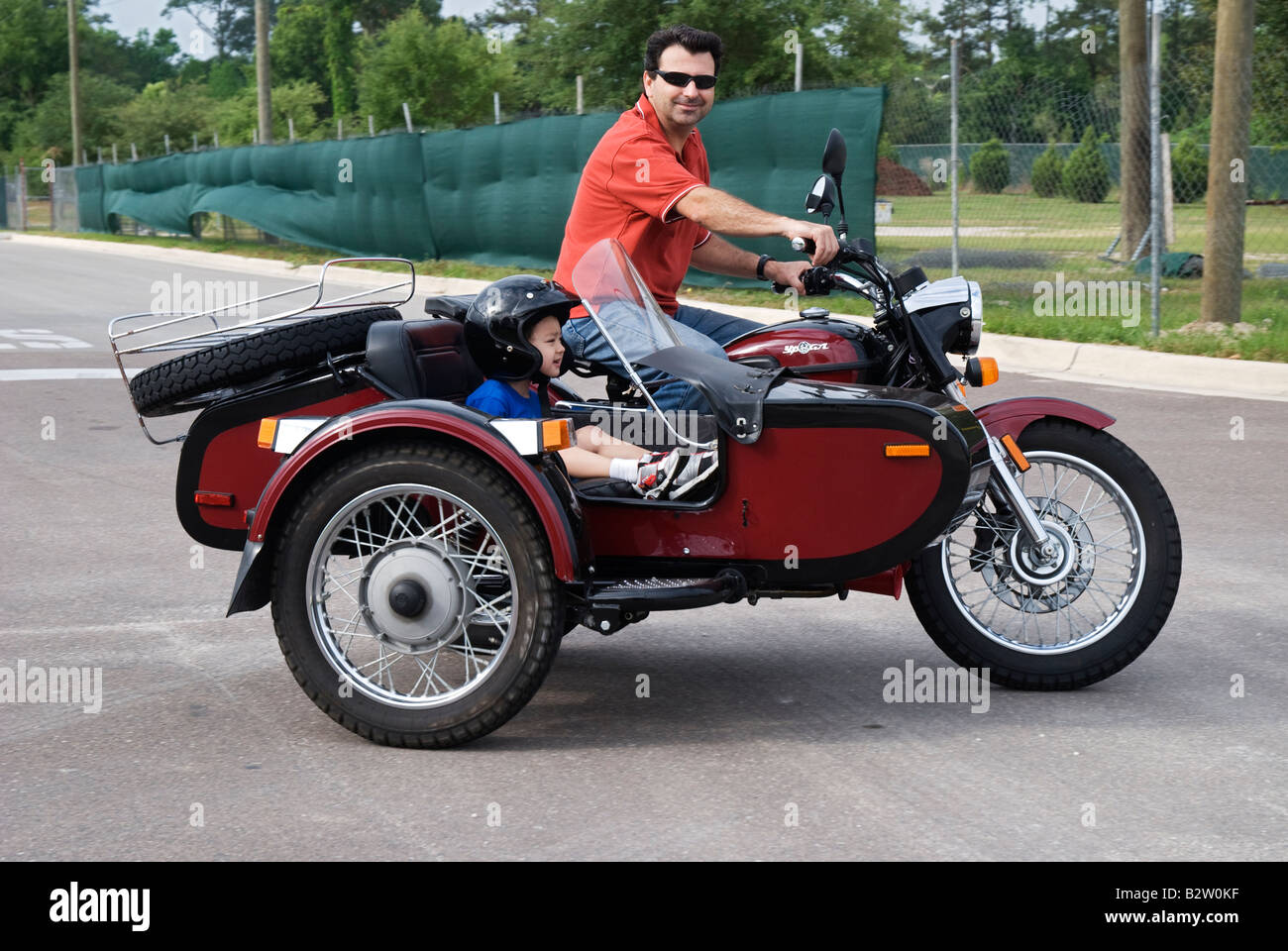 man on motorcycle with child in sidecar gainesville florida ural ypan stock photo royalty free. Black Bedroom Furniture Sets. Home Design Ideas