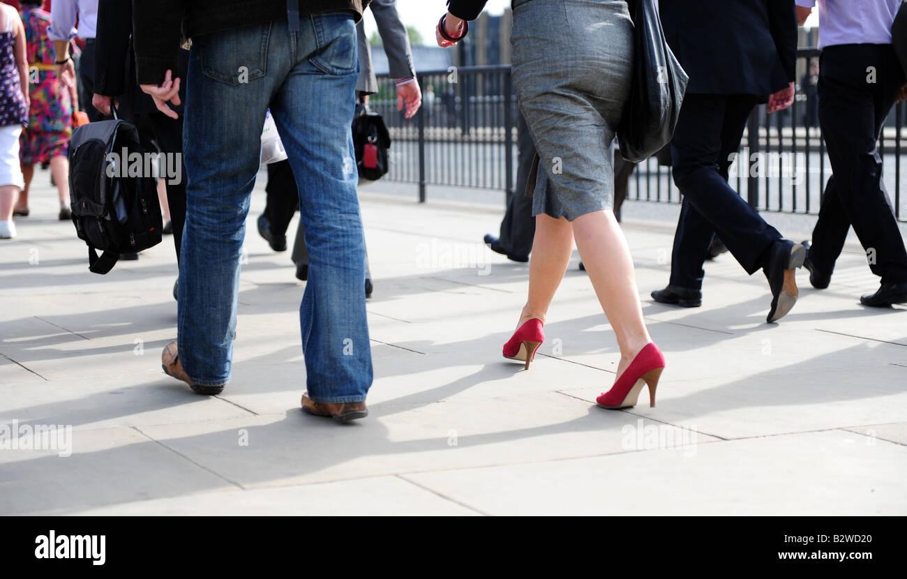 commuters walking over london bridge on their way to work w stock photo commuters walking over london bridge on their way to work w red shoes people walking man walking w walking feet