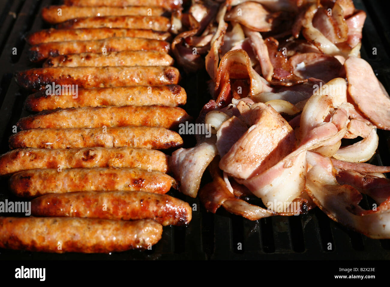 Cooking Bacon And Sausages On A Bbq In The Summer In Australia