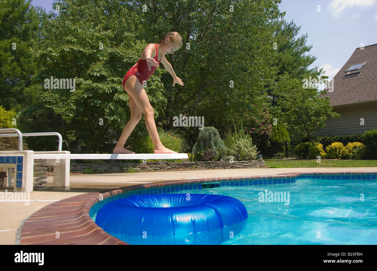 Exceptional Child Getting Ready To Dive Into A Swimming Pool