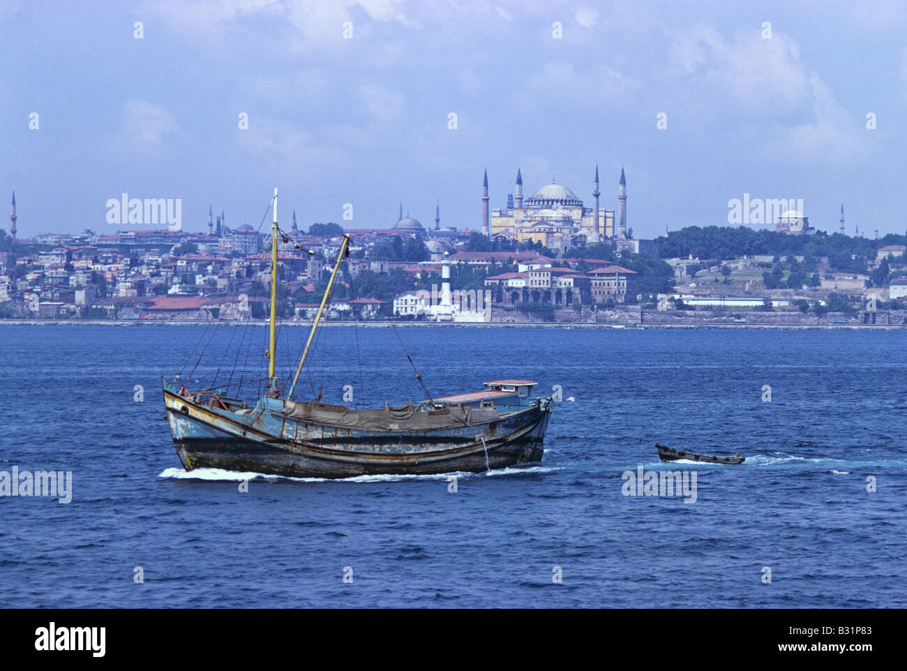 small-boat-in-the-bosphorus-aya-sofya-in-the-background-istanbul-680806-B31P83.jpg