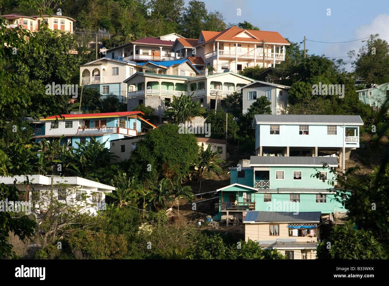 Hillside homes colourful houses built on a hillside in for Hillside homes