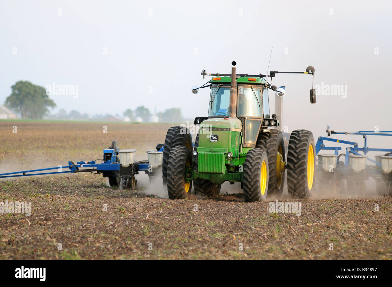 Tractor In Field Planting : John deere tractor planting corn or soybeans in an