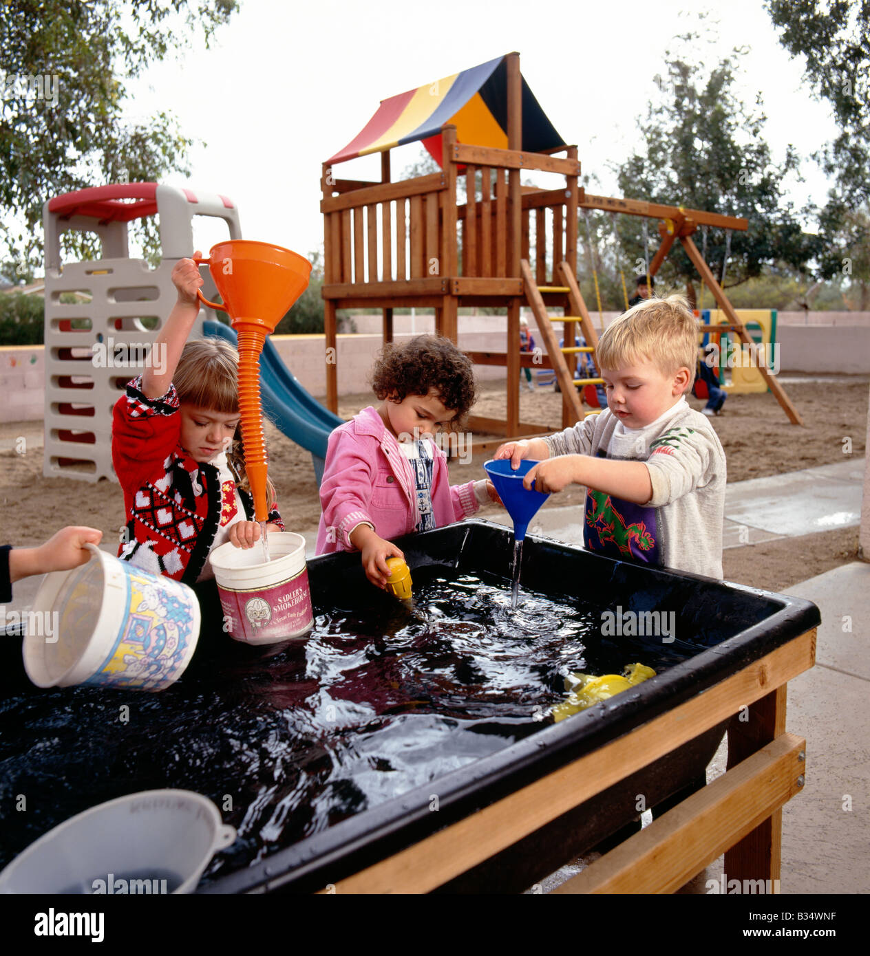 young children playing at a water table game in an arizona preschool stock photo 19162347 alamy. Black Bedroom Furniture Sets. Home Design Ideas