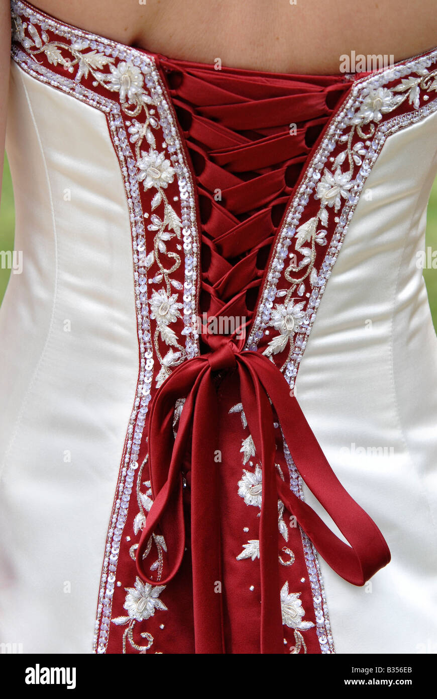 The back of a brides red and white wedding dress showing the the back of a brides red and white wedding dress showing the lacing decoration and bow junglespirit Gallery
