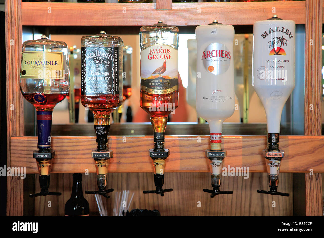 Alcoholic spirits on an optic stand in a pub bar setting for Stand pub