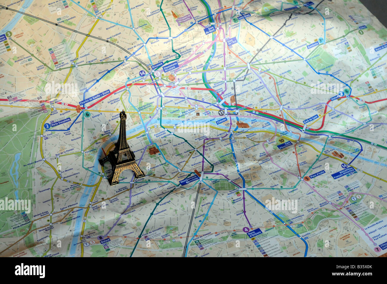 a smallscale model of the eiffel tower standing on a map