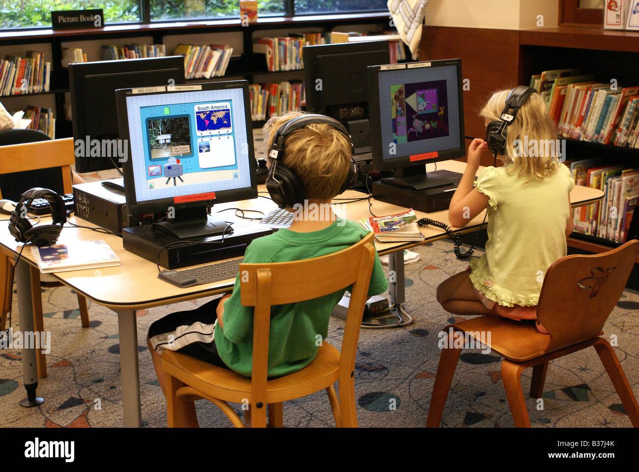 two children using computers in public library Stock Photo ...