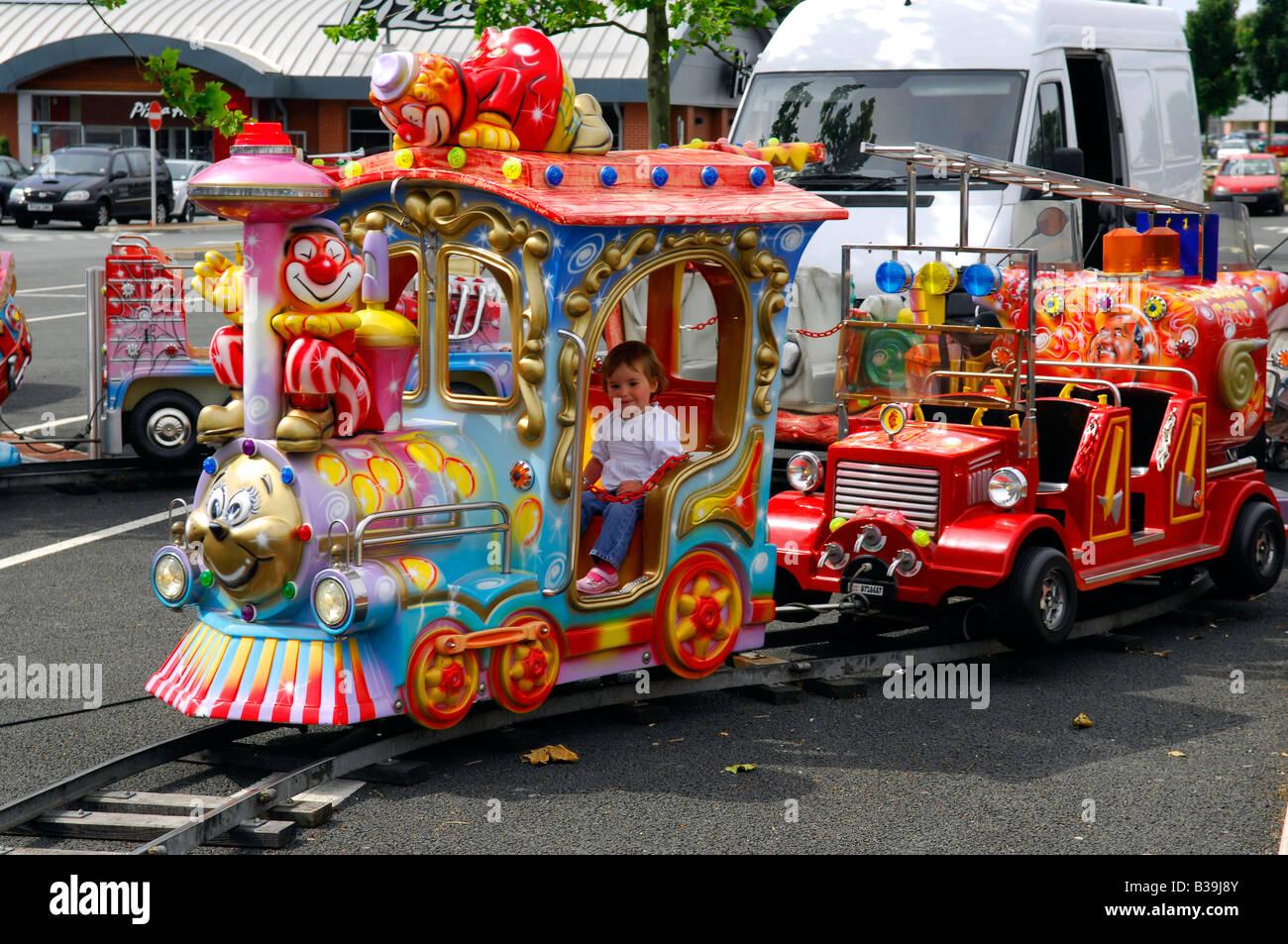 kiddies fairground ride choo choo train children colour fun Stock ...