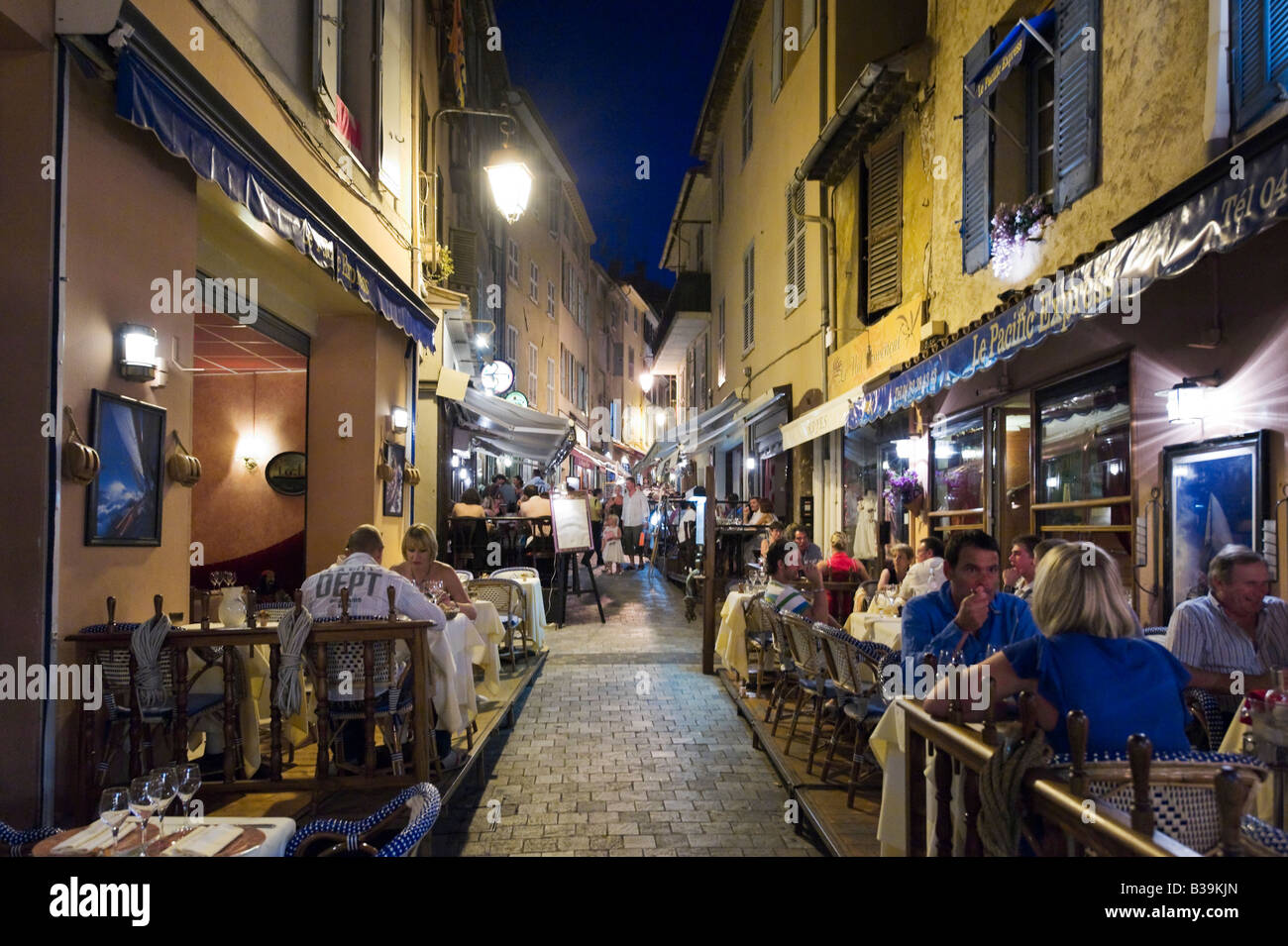 resaurant on the rue du suquet in the old town le suquet at night stock photo royalty free. Black Bedroom Furniture Sets. Home Design Ideas
