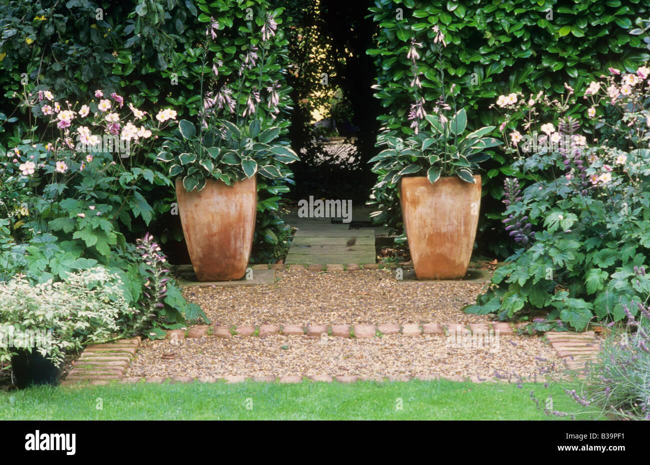 Pair Of Ceramic Terracotta Pots Containers Planters Hosta Gravel Brick Path  Laurel Hedge Small Garden Design Lawn Anemone Flower