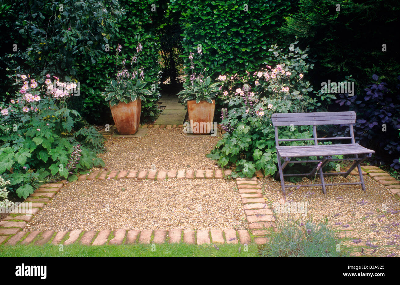 Garden Furniture On Gravel terracotta planters with hosta, brick gravel path blue painted