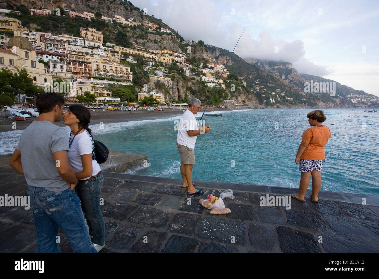 People fishing on the public dock in positano on the for Public fishing areas