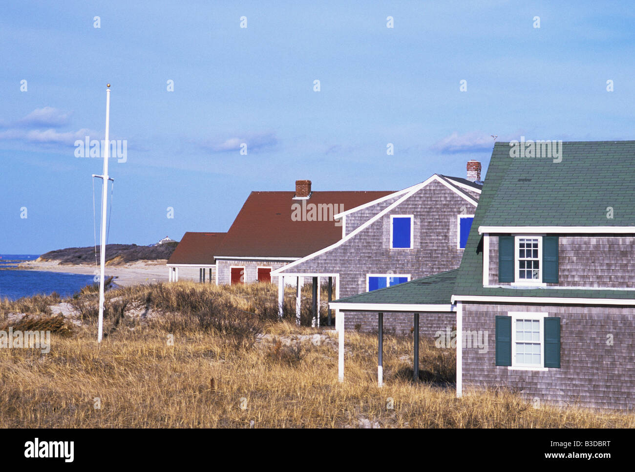 Scenic view of multi color cape cod beach houses in dennis for Cape cod beach homes