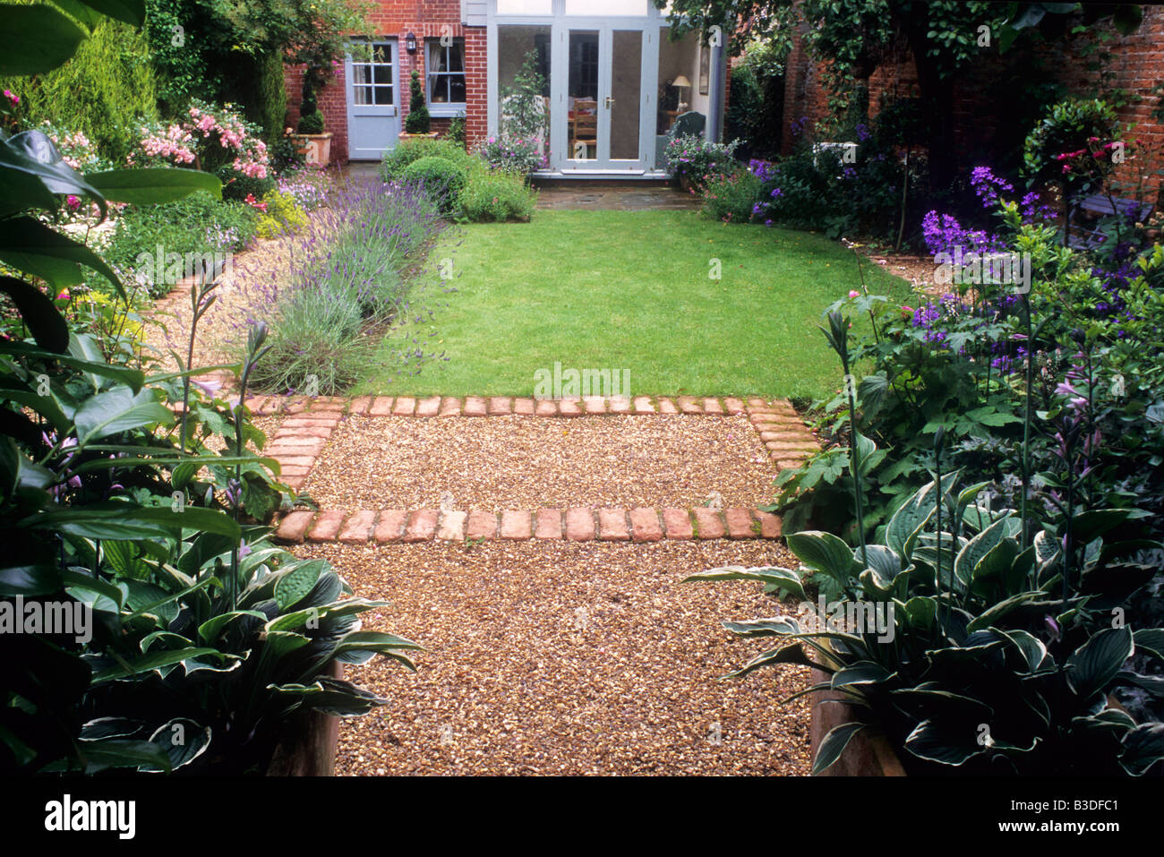 Path gravel brick small back garden design lawn house border