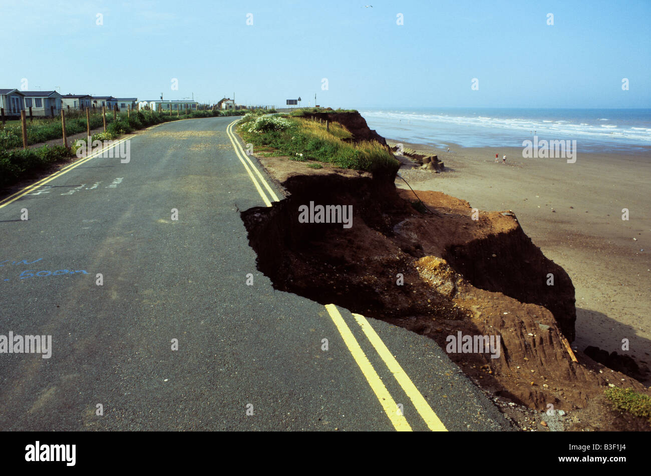 coastal erosion of cliff and road surface at Skipsea East coast of ...