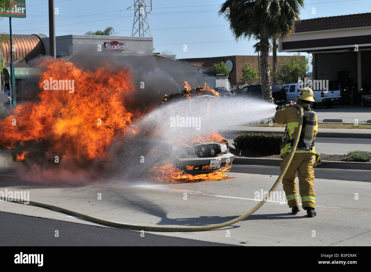 Lovely Exceptionnel Firefighter Putting Out Fire On Burning Mercedes Stock Image