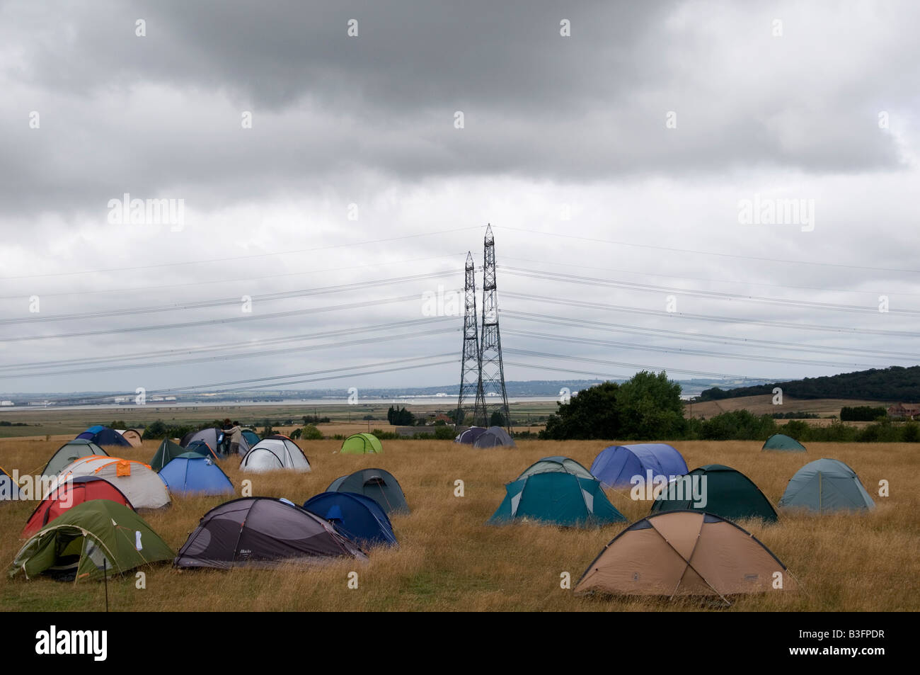 August 8th 2008 Climate C& near Kingsnorth Power station Kent View of tents and power lines & August 8th 2008 Climate Camp near Kingsnorth Power station Kent ...