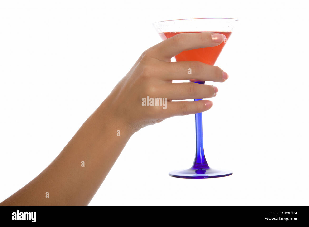 Woman hand hold wineglass with sweet cocktail stock photo royalty woman hand hold wineglass with sweet cocktail ccuart Gallery