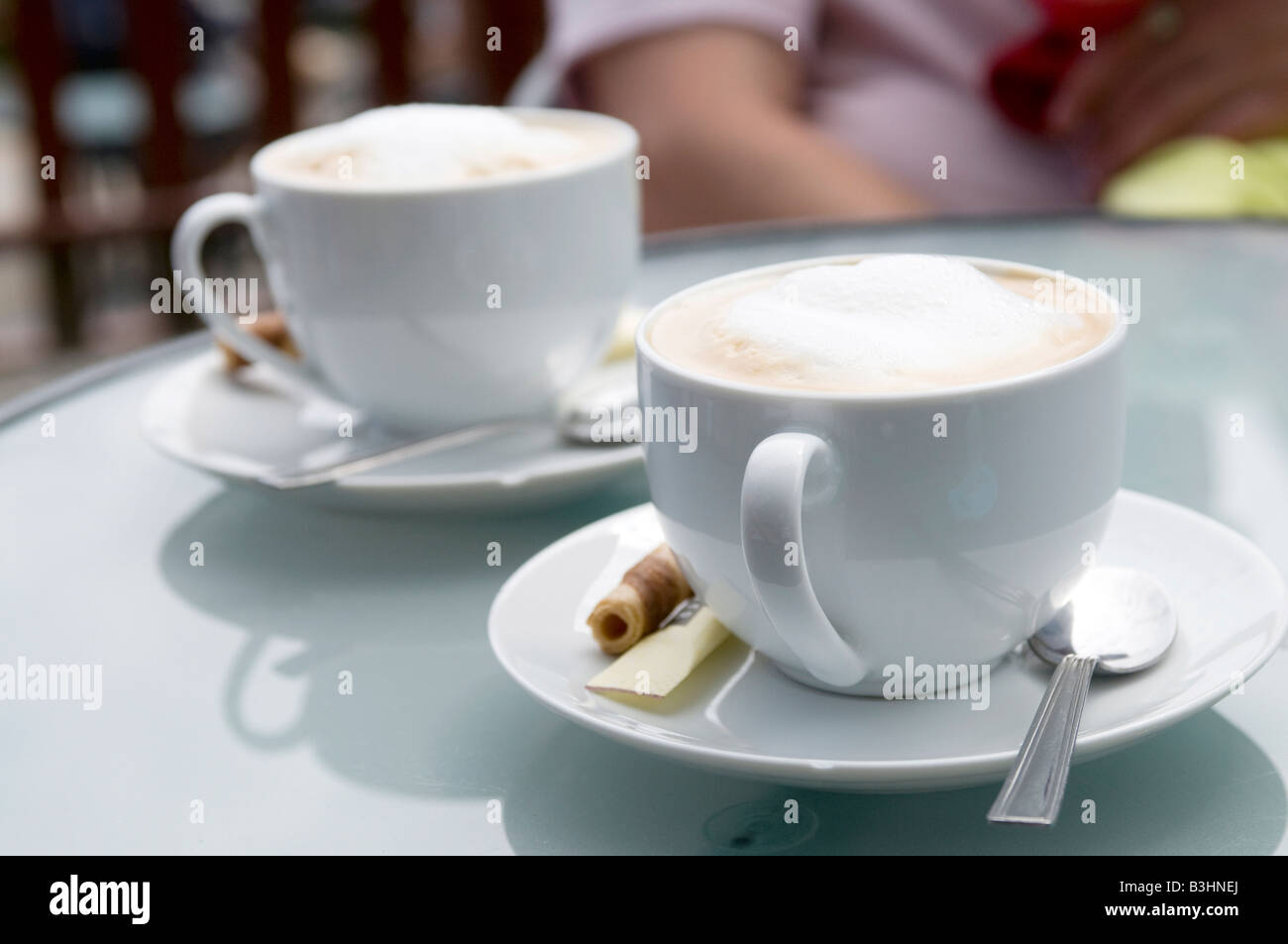 Two coffee cups on outdoor restaurant table stock photo royalty two coffee cups on outdoor restaurant table geotapseo Gallery