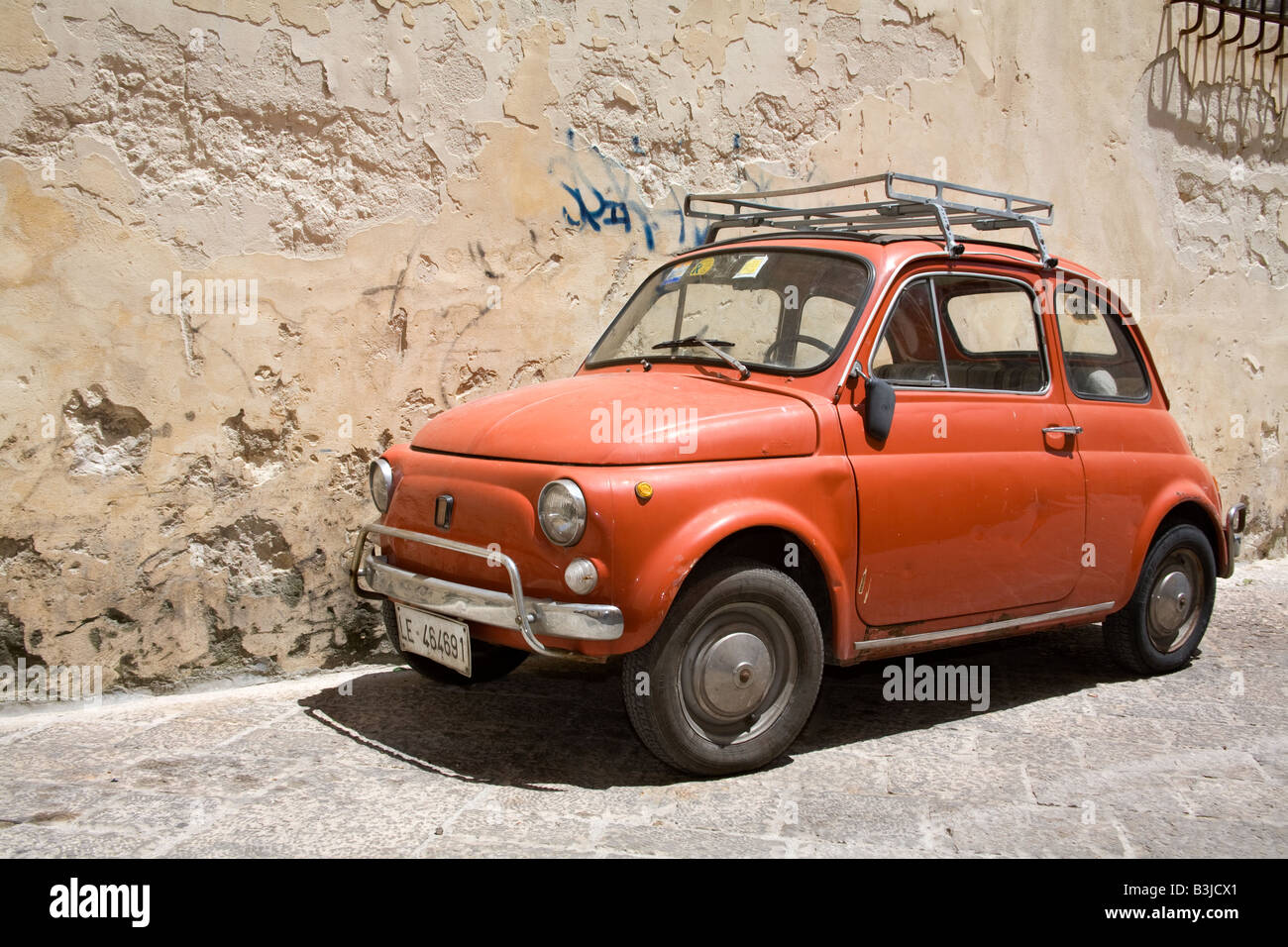 old red fiat 500 car with roof rack parked in lecce city southern stock photo royalty free. Black Bedroom Furniture Sets. Home Design Ideas