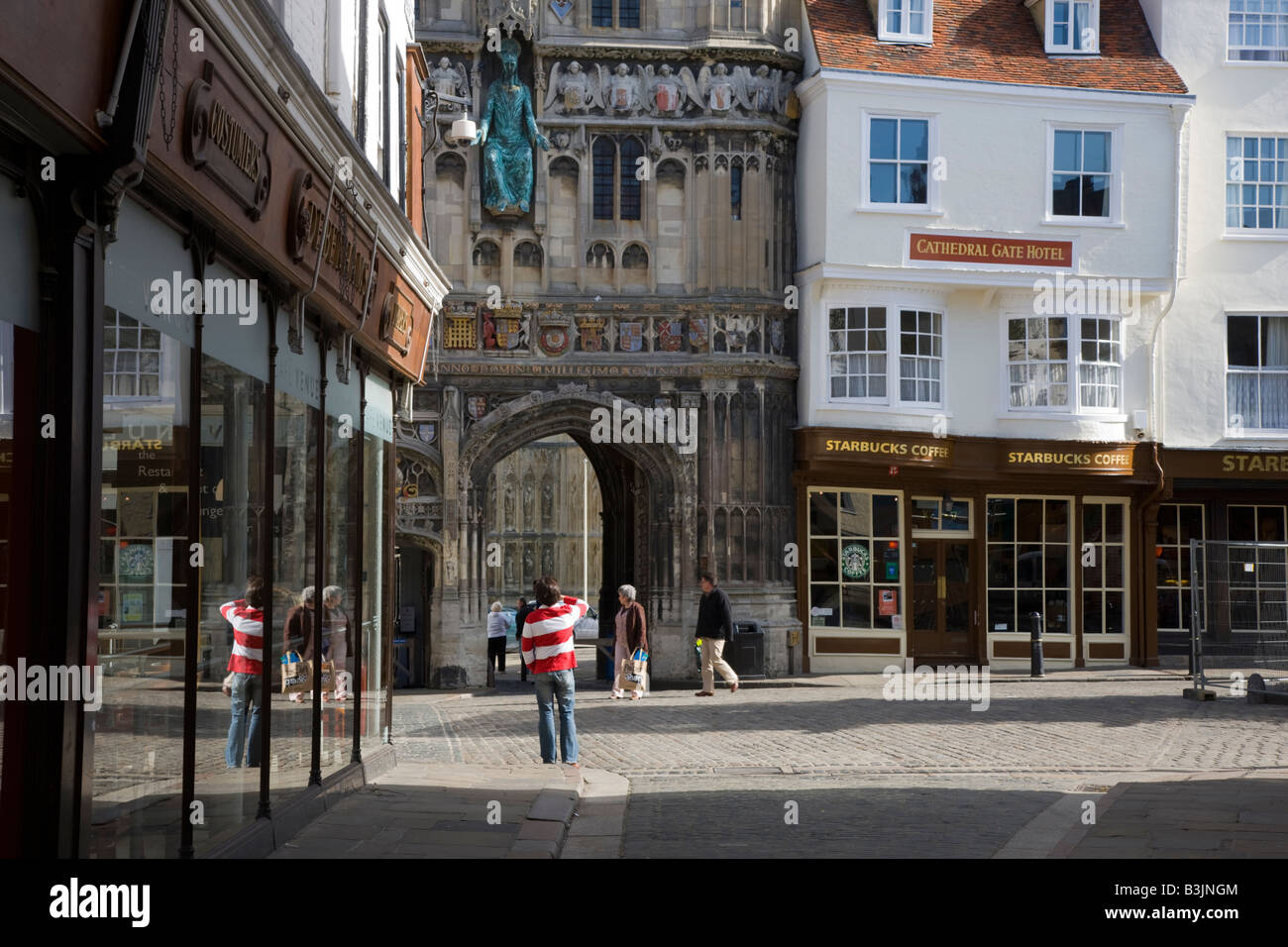 Delightful Tourists Congregating Outside The Gated Entrance To Canterbury Cathedral