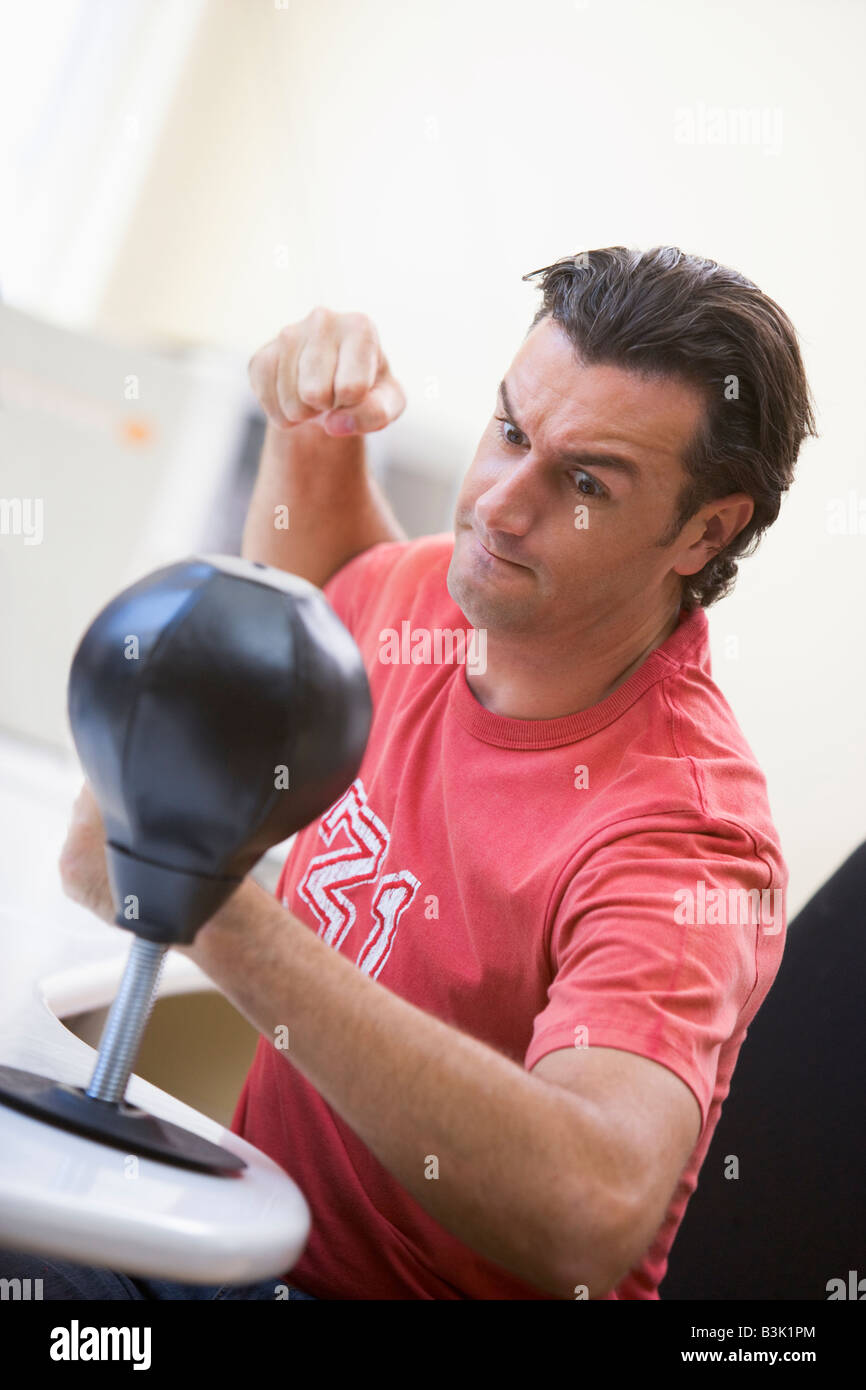 businessman in office using small punching bag to relieve stress stock image business nap office relieve
