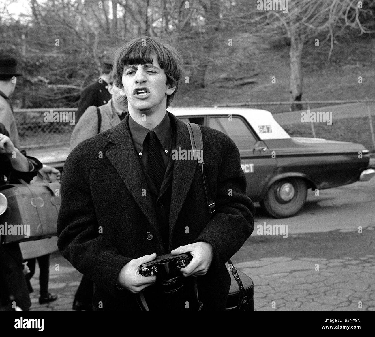 The Beatles February 1964 Ringo Starr holding camera in ...  The Beatles Feb...