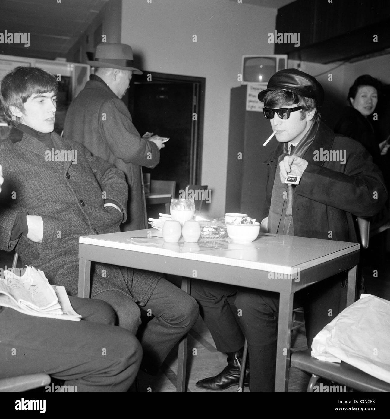 John Lennon and George Harrison of the Beatles pop group ...  John Lennon and...