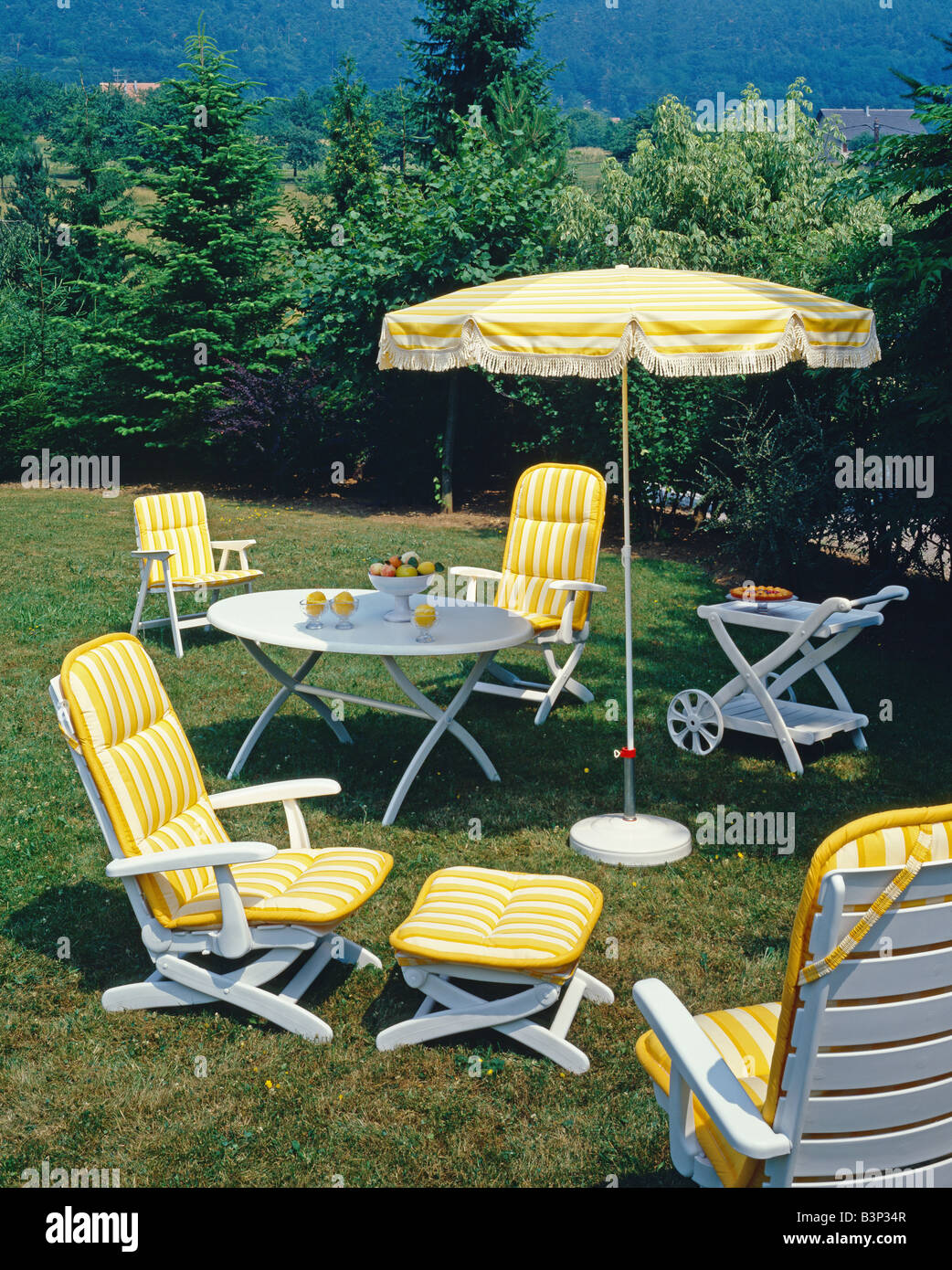 GARDEN FURNITURE CHAIR ARMCHAIRS AND PARASOL DECORATED WITH YELLOW STRIPED  FABRIC. GARDEN FURNITURE CHAIR ARMCHAIRS AND PARASOL DECORATED WITH YELLOW
