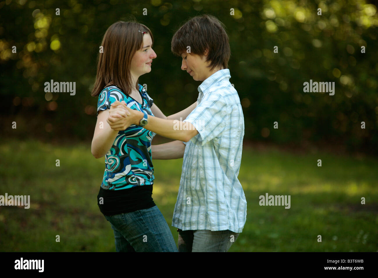 teenage girl teaching a boy how to dance (in vain Stock Photo ...