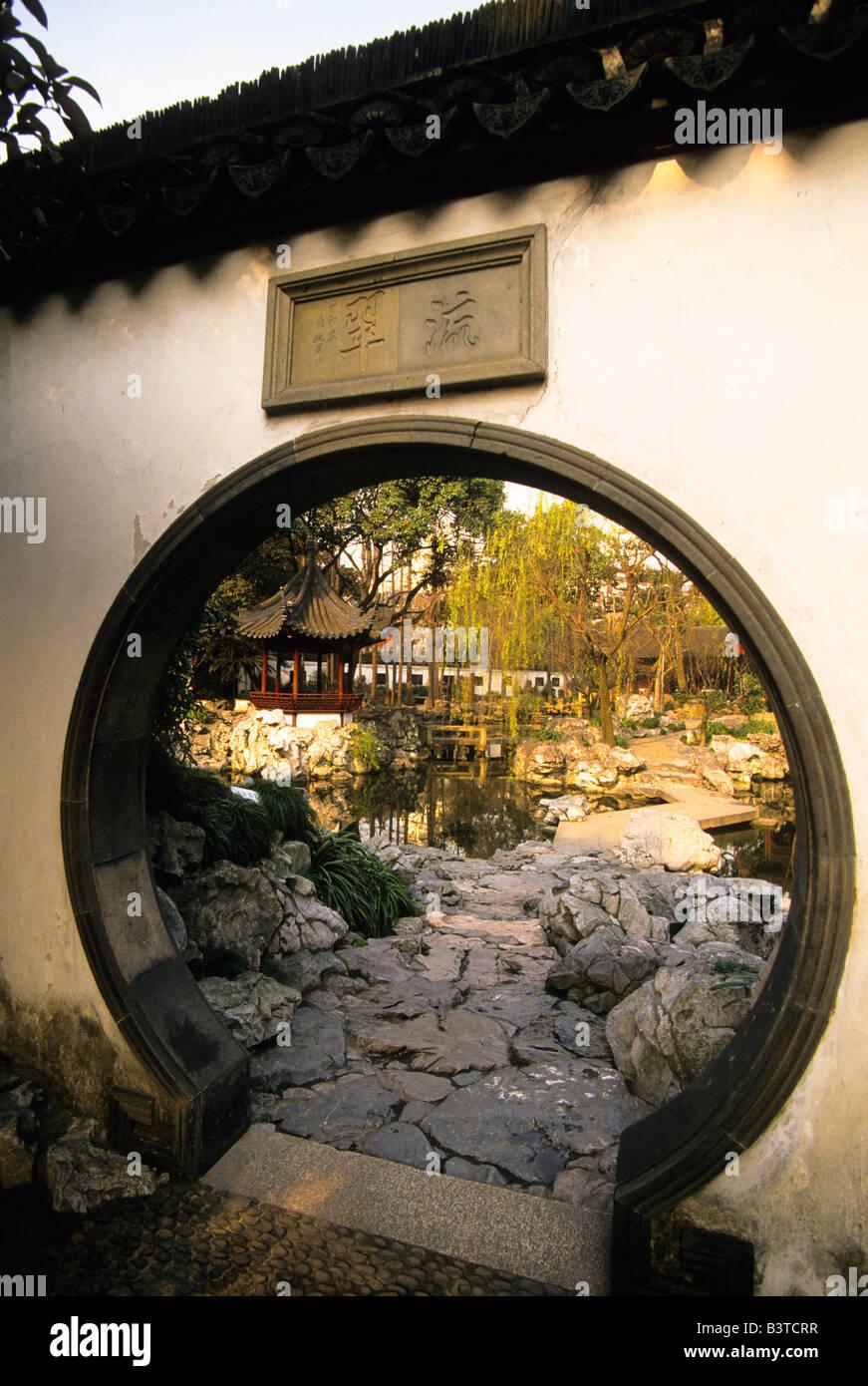 Decorating circular door images View of Yuyuan Gardens through the circular door in a traditional ...