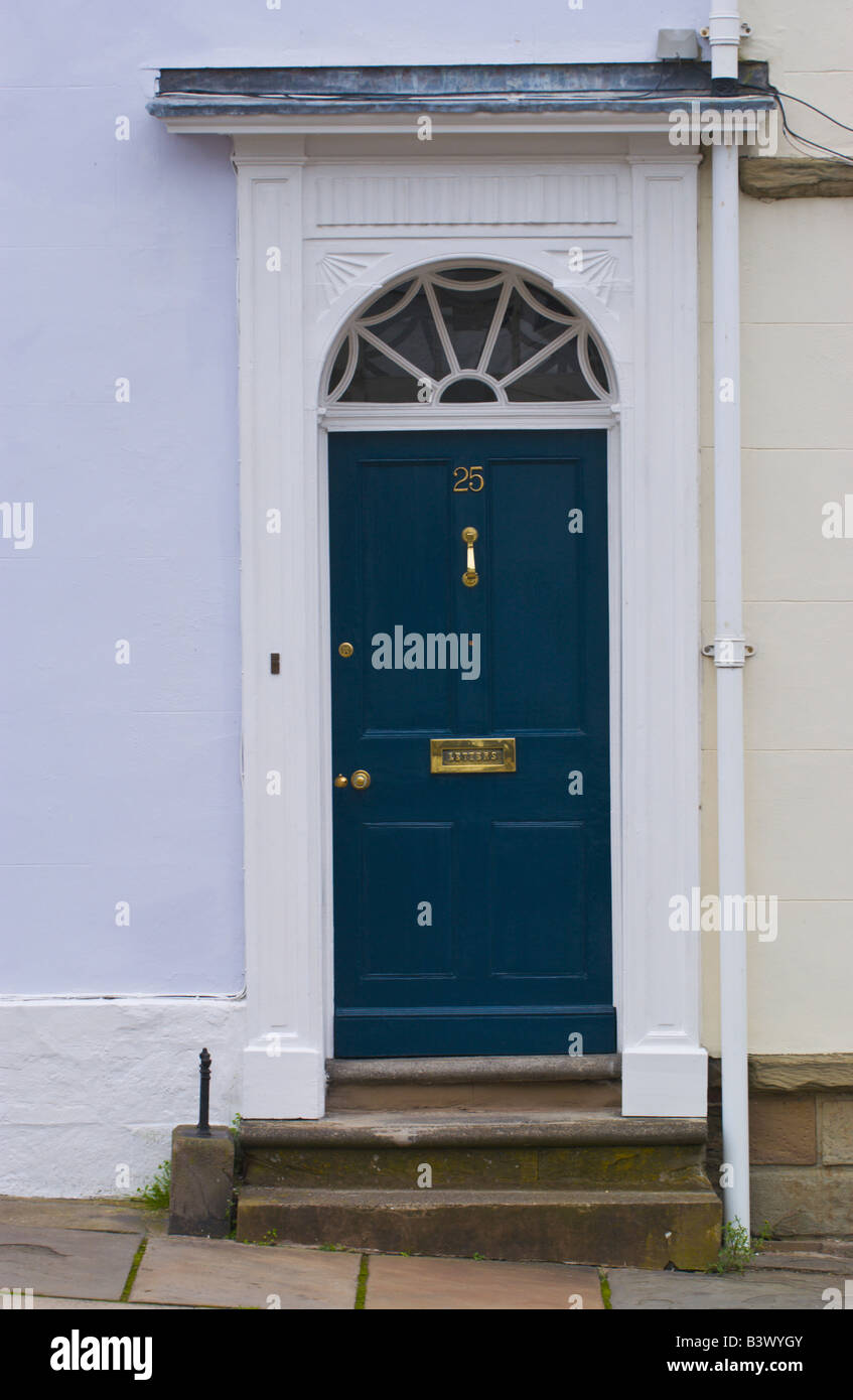 Blue Panelled Front Door With White Frame And Semi