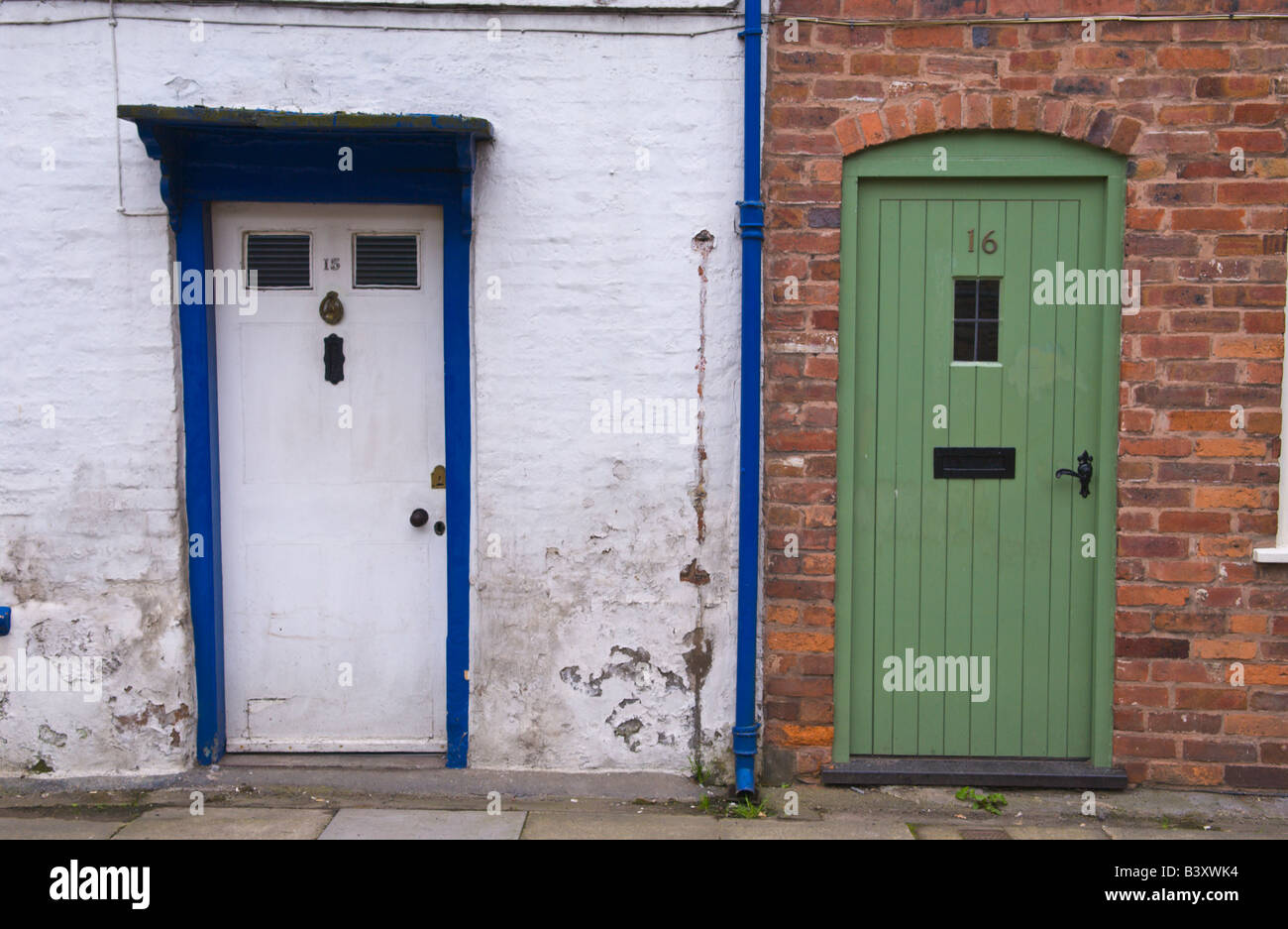 green front doorsWhite and green front doors of terraced cottages in Ludlow