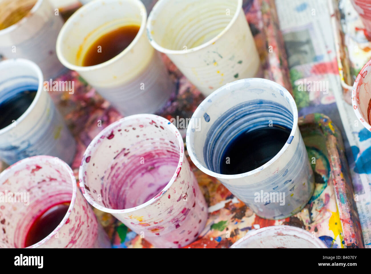 How to clean paintbrushes - Stock Photo Dirty Water In Plastic Cups Used To Clean Paint Brushes During An Art Lesson In A Uk School