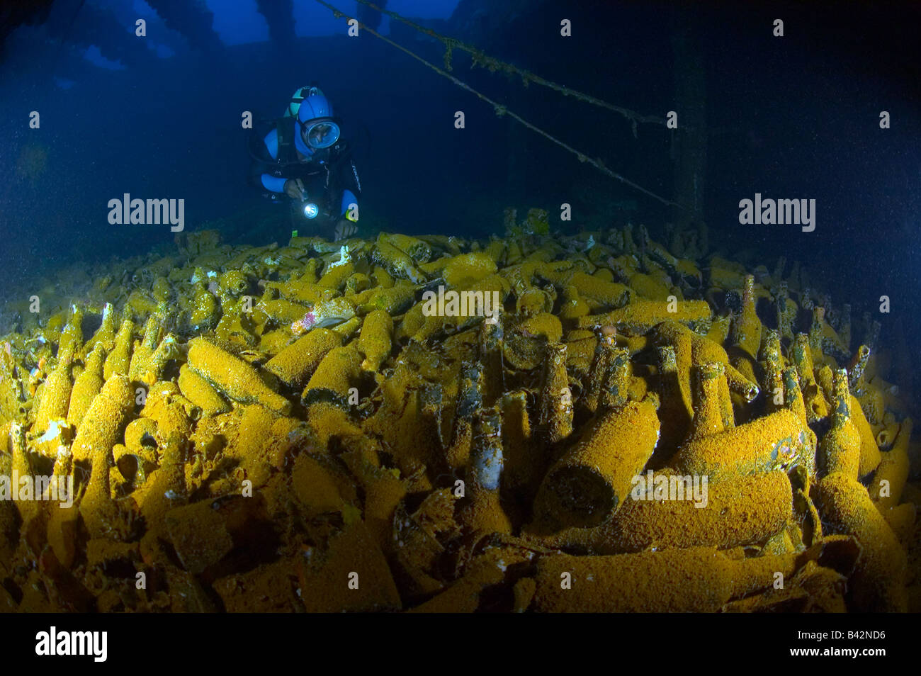 Diver finds stowage with bottles at wreck fujikawa maru truk lagoon caroline islands pacific ocean chuuk