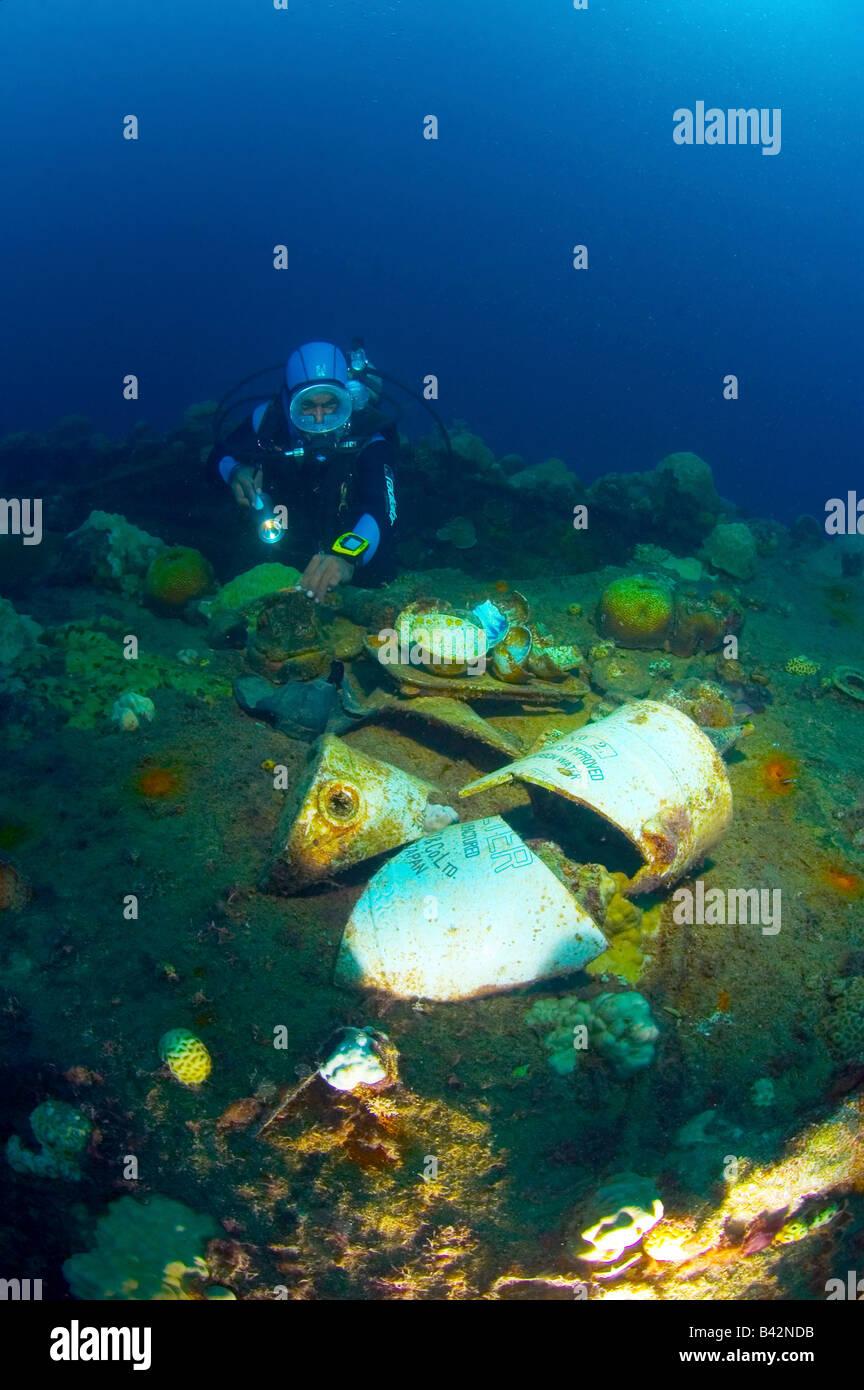 Diver finds artifacts at wreck fujikawa maru truk lagoon caroline islands pacific ocean chuuk micronesia