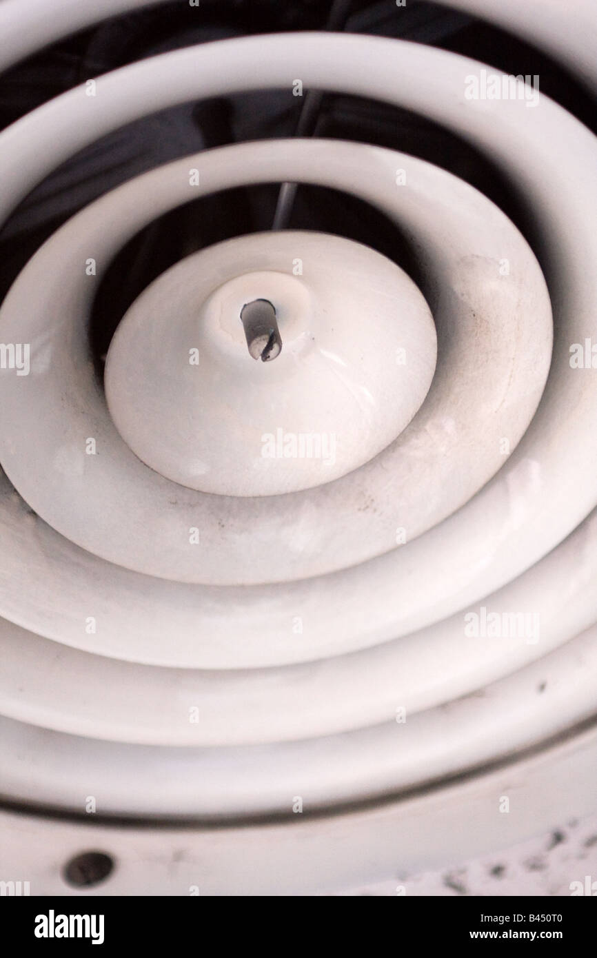 abstract photo of a circular air conditioning ceiling vent stock