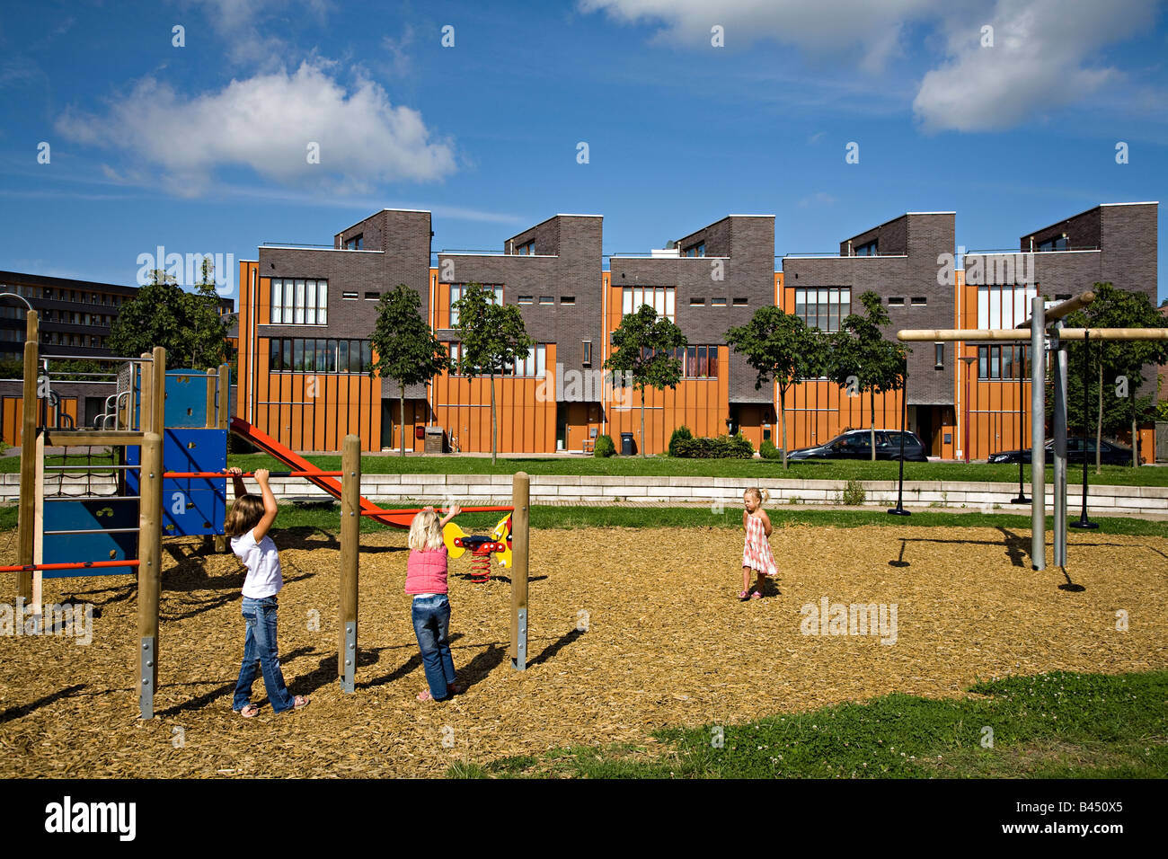 Modern Architecture Netherlands children in playground with modern architecture buildings and wood
