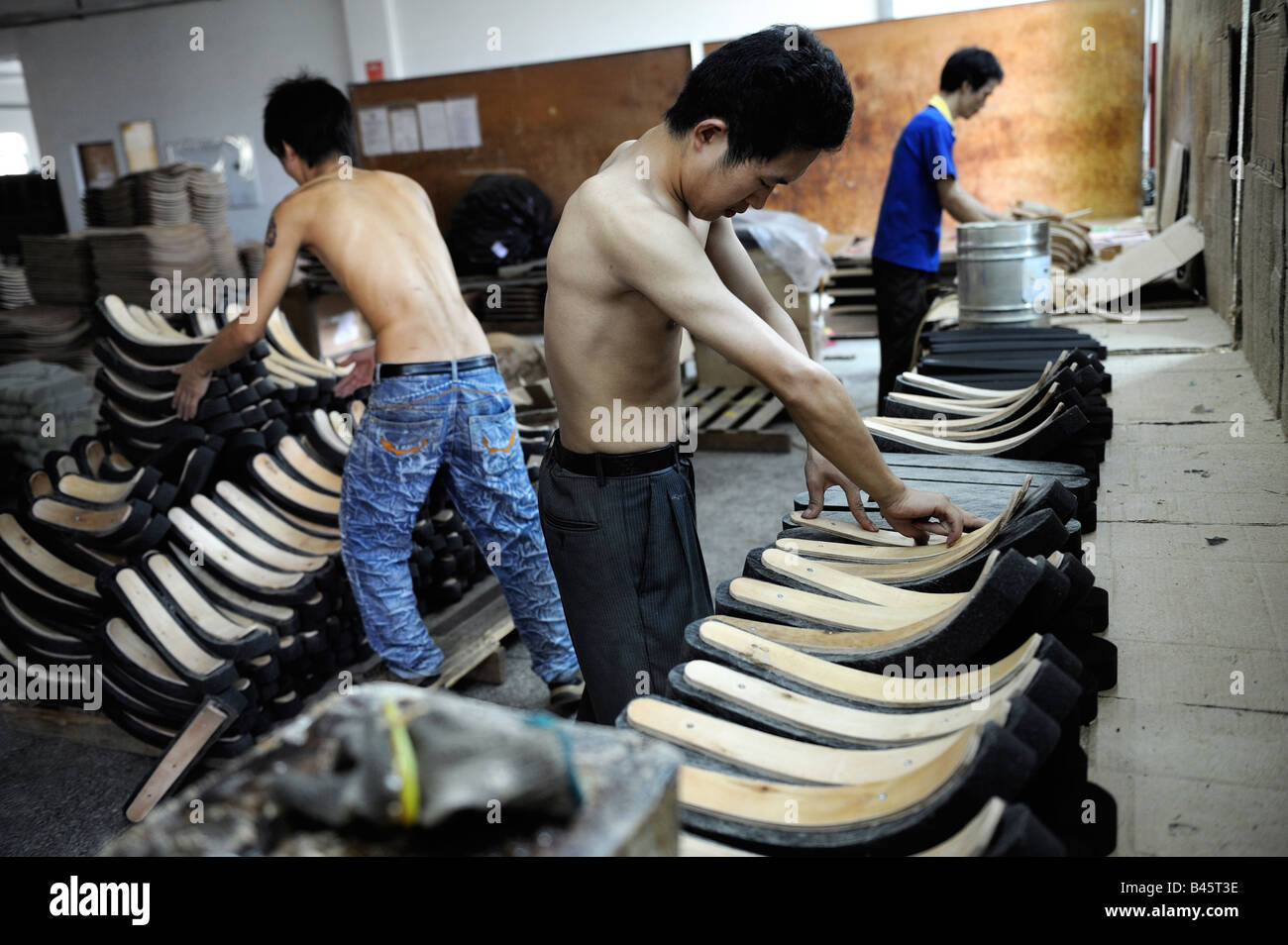 Laborers Spray Glue For Office Chairs At A Taiwan Capital Furniture Factory In Huizhou Guangdong China 21 Sep 2008
